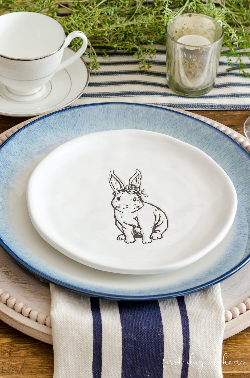 Black and white bunny salad plates on blue plate with whitewashed wooden charger plate