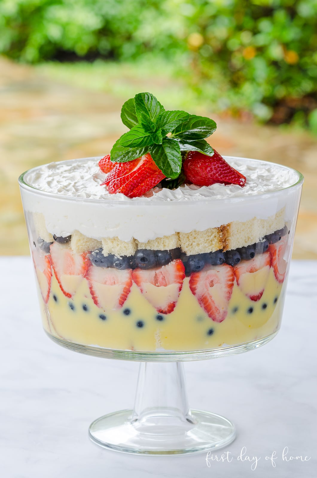 Strawberry trifle with pudding , pound cake, strawberries, blueberries and whipped cream