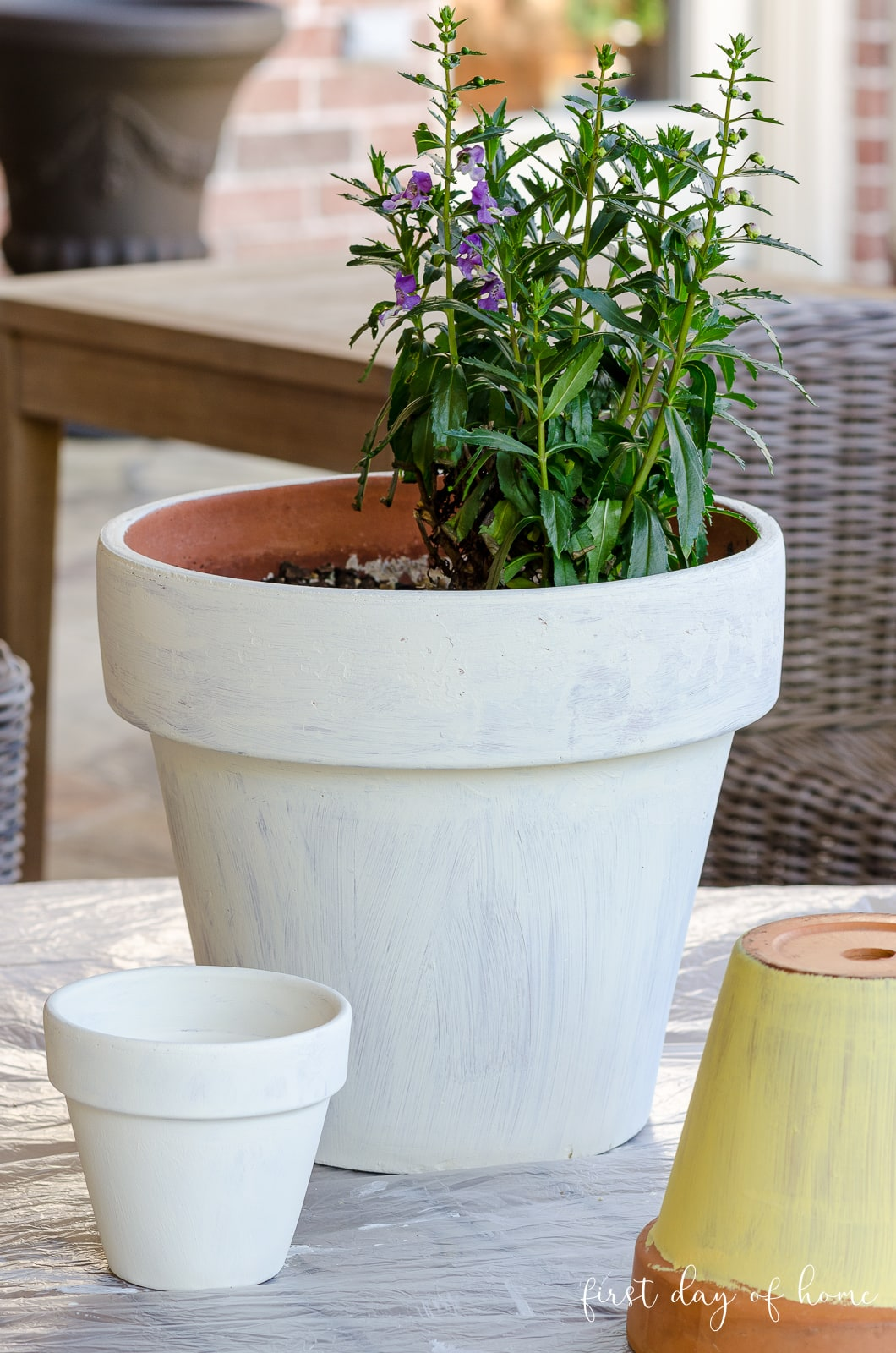 White painted terracotta pots before applying Mod Podge Outdoor for decoupage