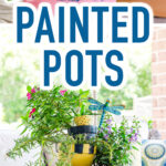 "Painted flower pots stacked on a table with text overlay reading ""DIY Painted Pots"""