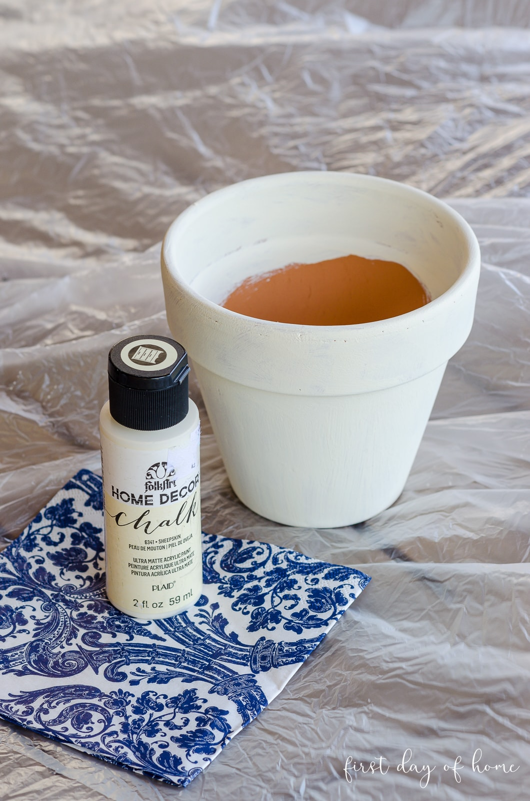Chalk paint used for painting a small clay pot
