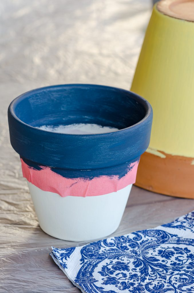 Terracotta pot with blue and white paint