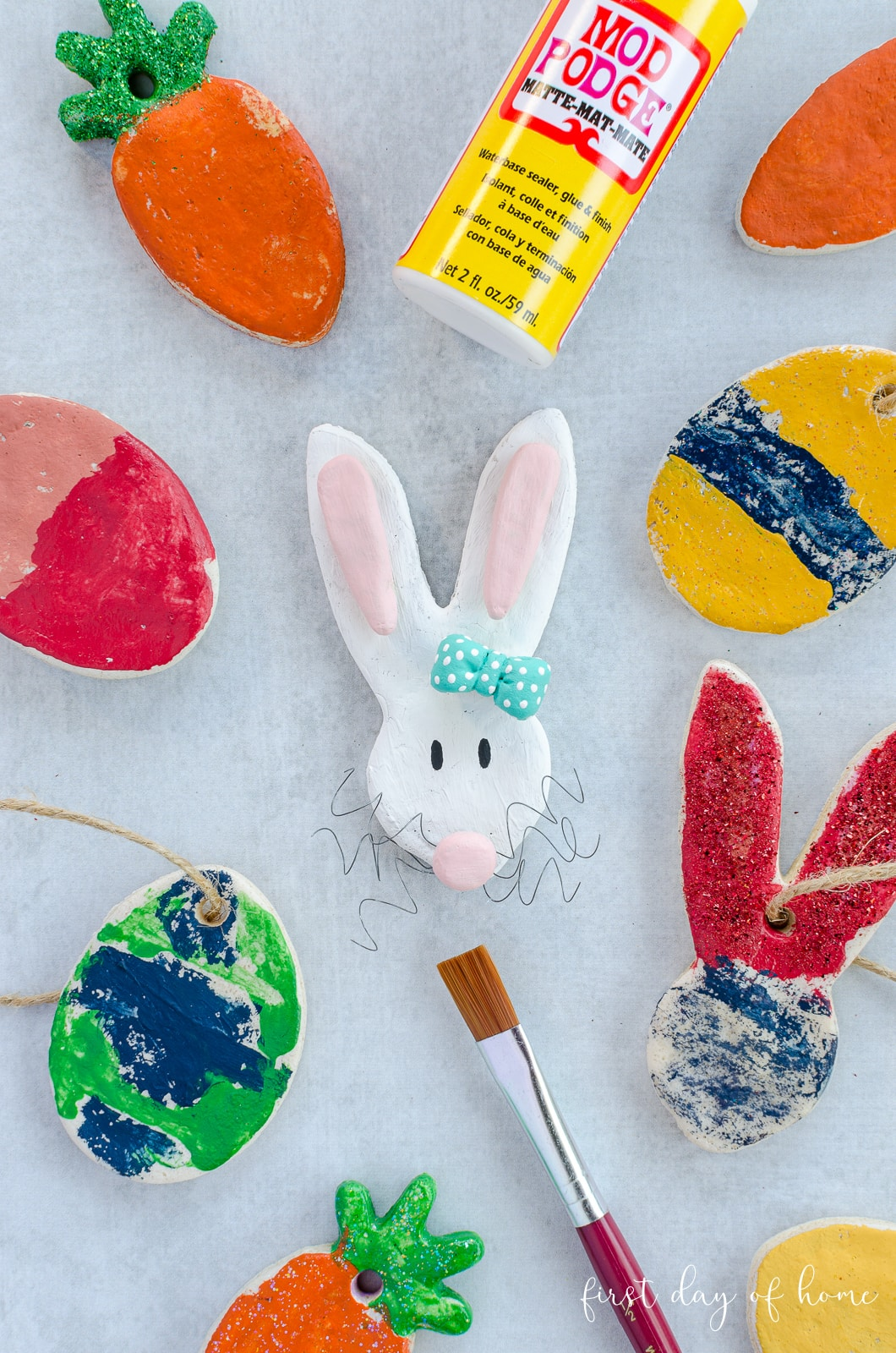 Salt dough ornaments in Easter shapes, colored with acrylic paint and sealed with Mod Podge Sparkle