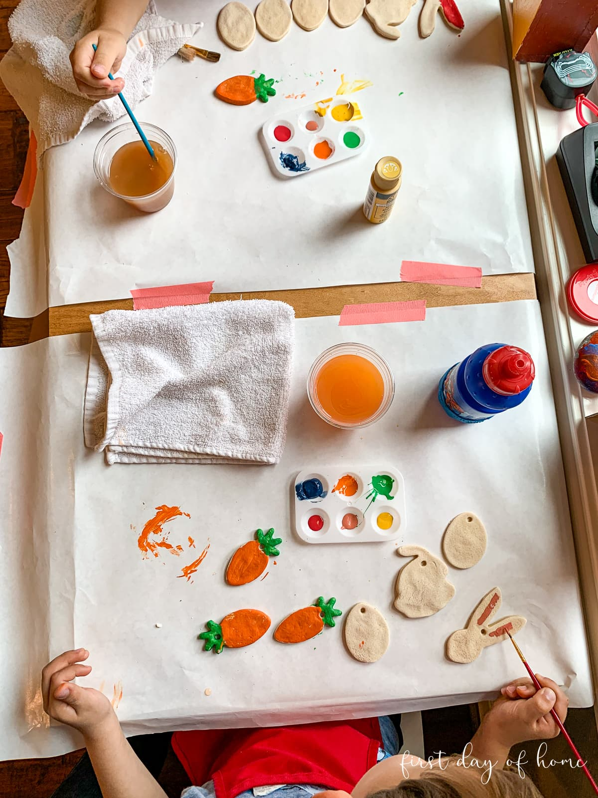 Kids painting salt dough ornaments for Easter