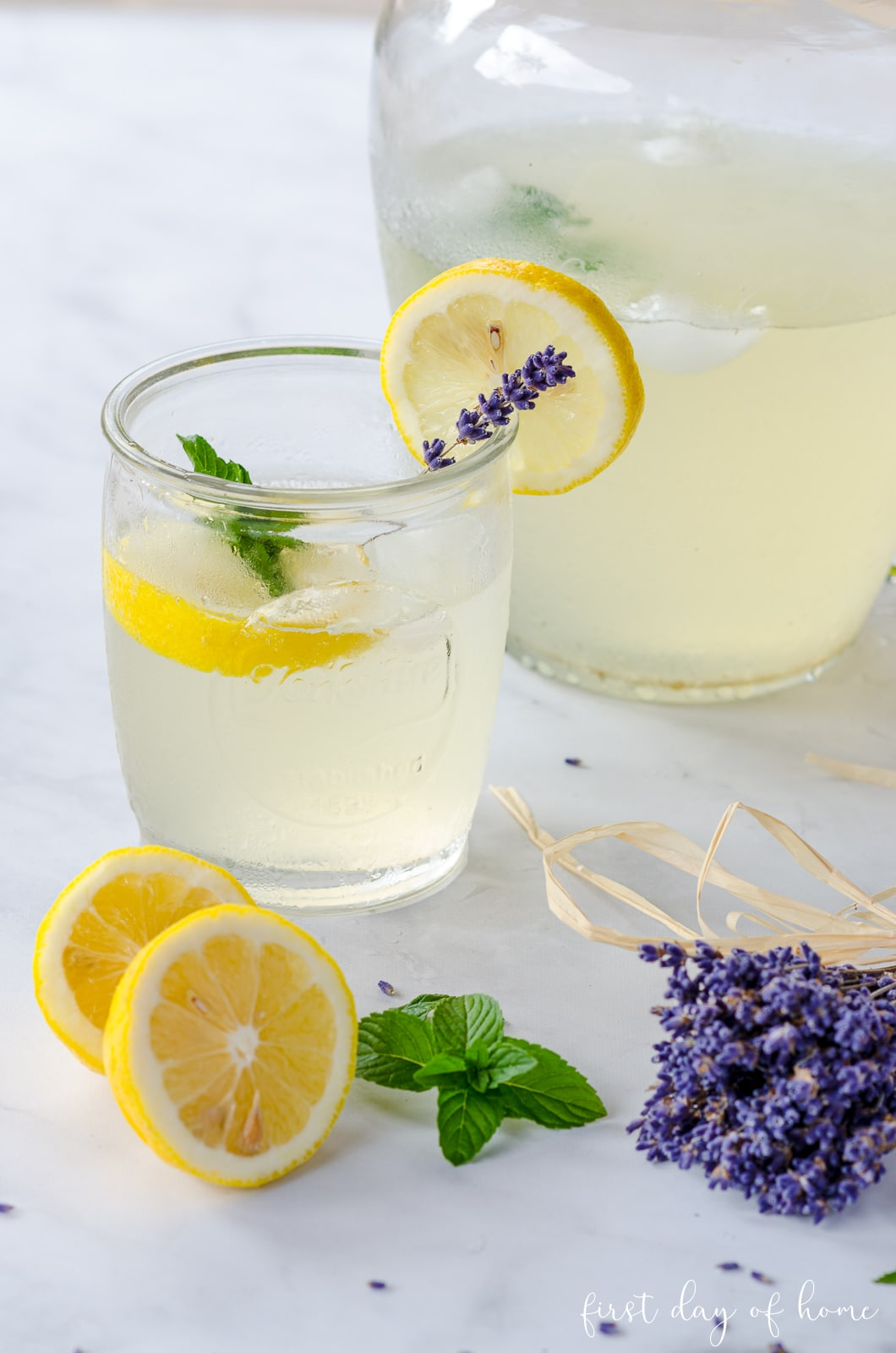 Lavender lemonade with mint in mason jar drinking glass