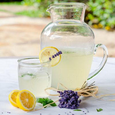 Lavender lemonade in pitcher and mason jar glass for Welcome Home Sunday weekly feature