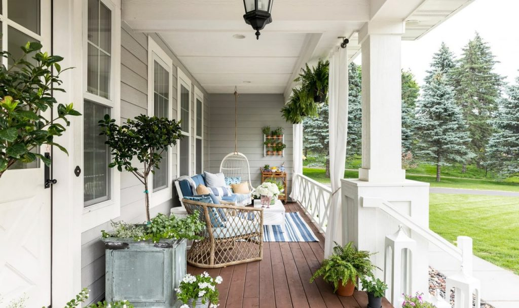 Outdoor front porch decor with blue and yellow color scheme by Bria Hammel Interiors