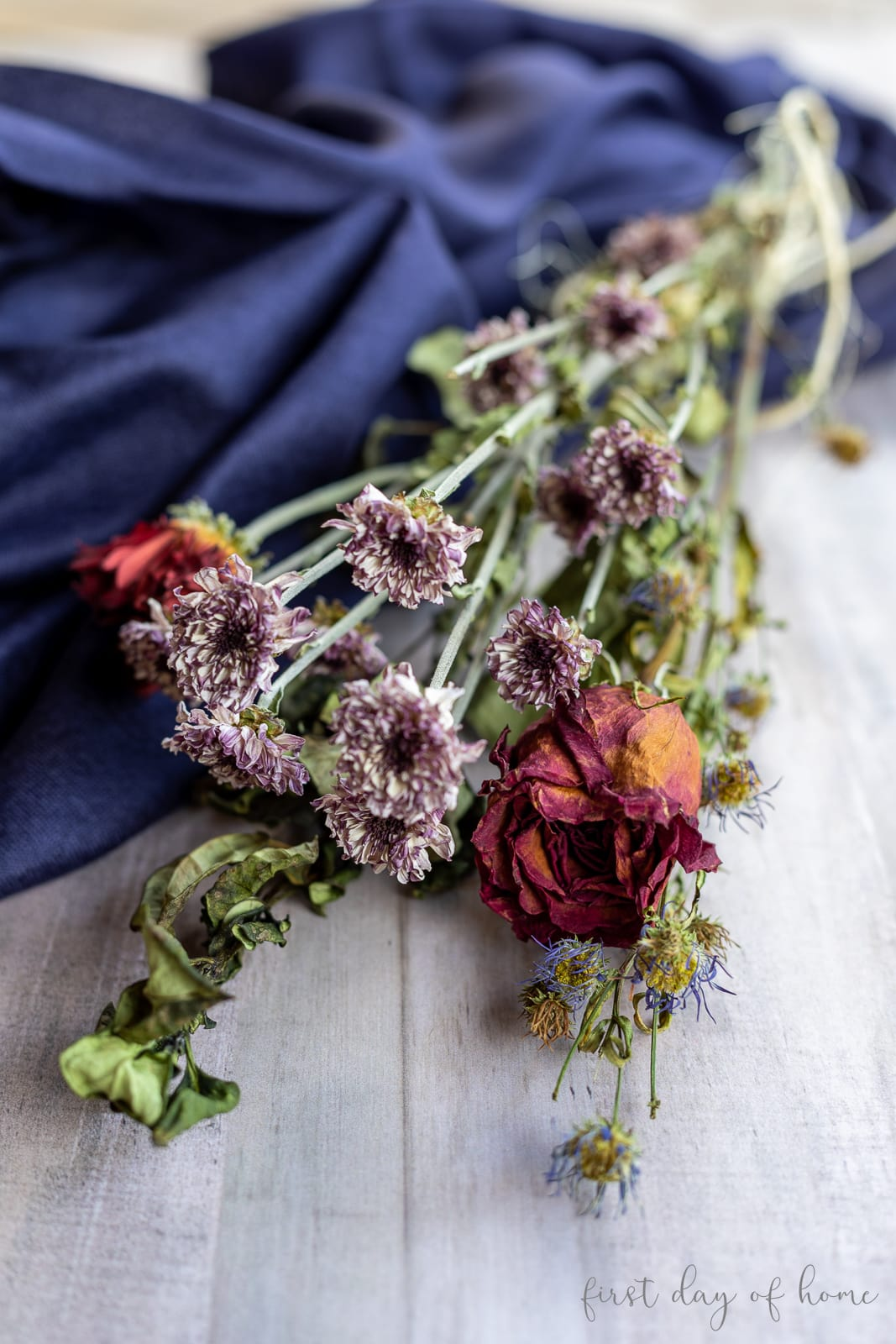 Dried flower bouquet with roses, mums and other dried leaves