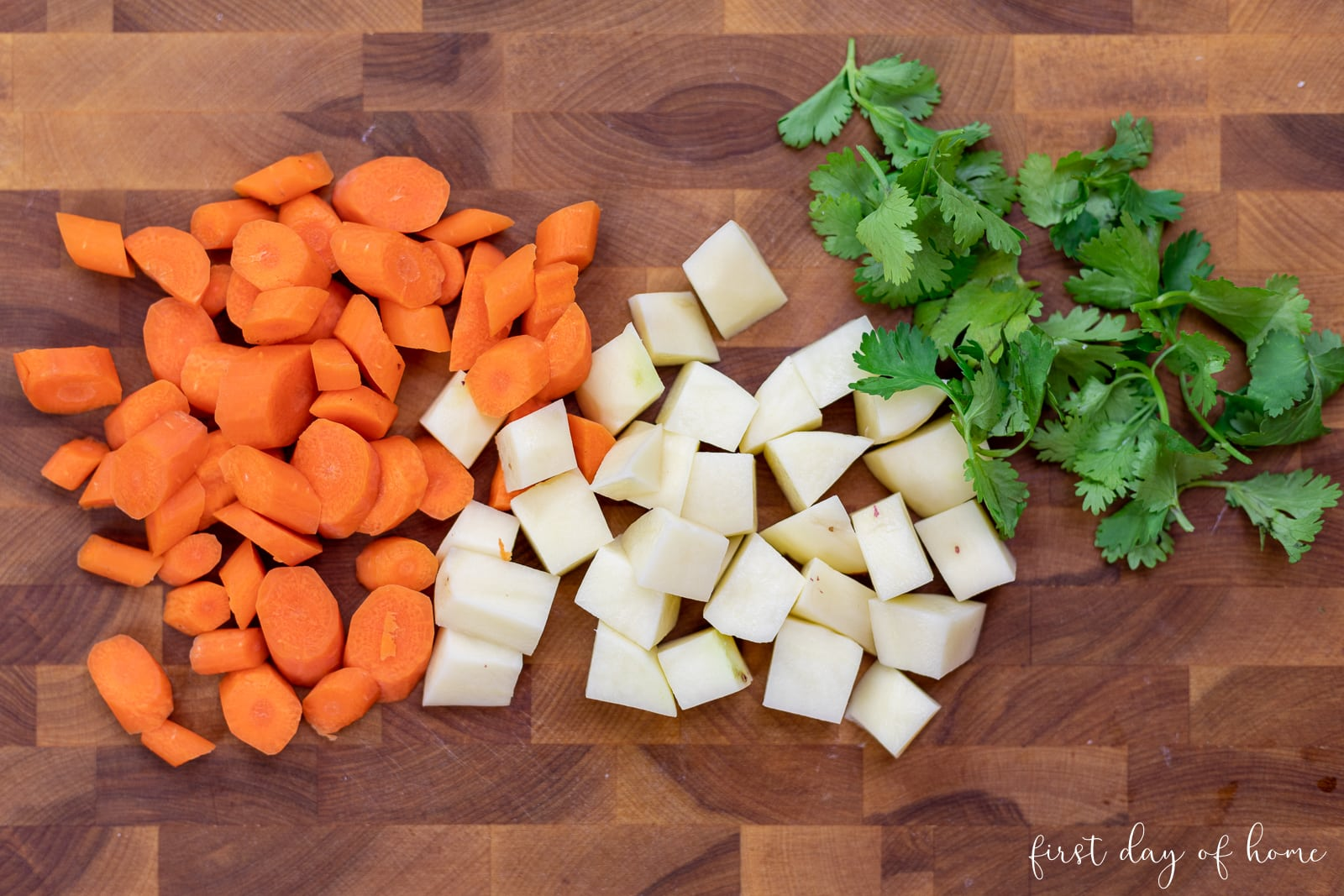 Sliced carrots and diced potatoes with cilantro
