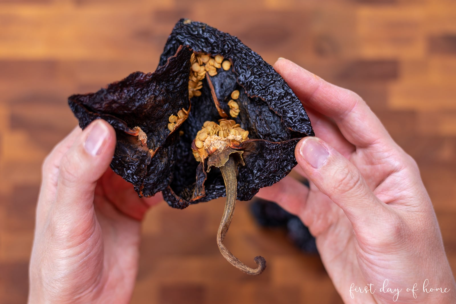 Removing seeds from ancho chile peppers