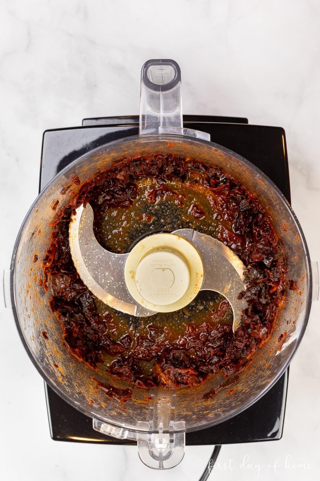 Red enchilada sauce in food processor after blending