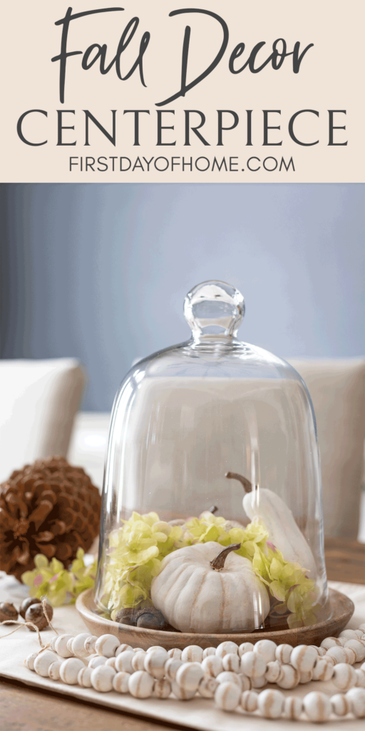 Fall glass cloche with green hydrangeas, acorns, pinecones, and DIY baby boo white pumpkins