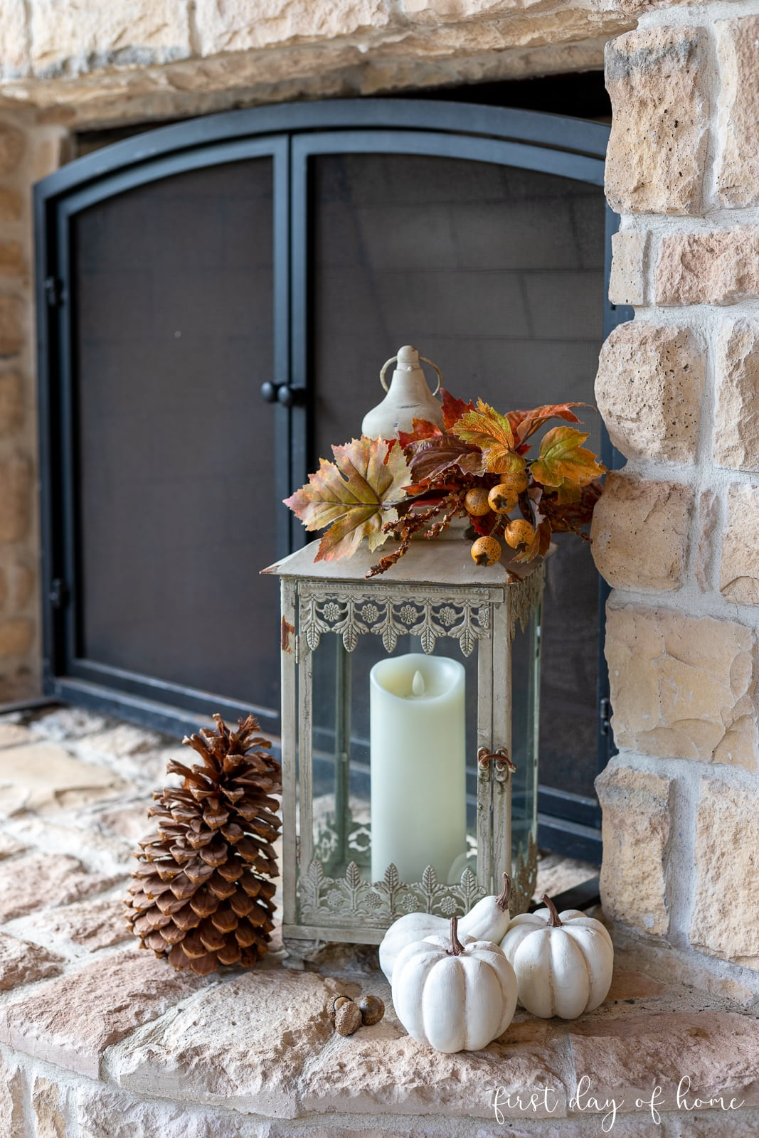 White painted pumpkins with lantern and fall foliage decor