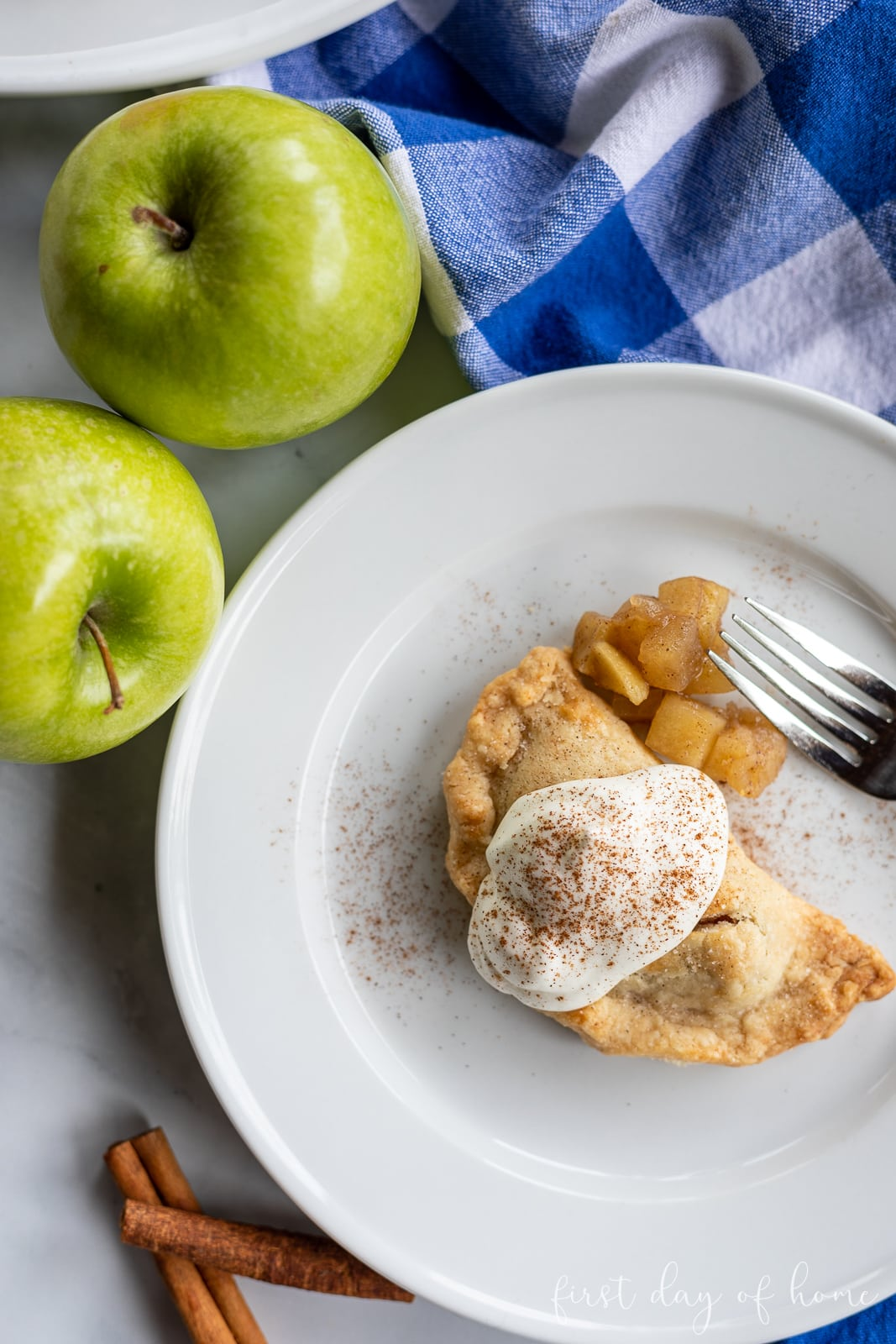Baked apple empanadas on plate with coffee in background