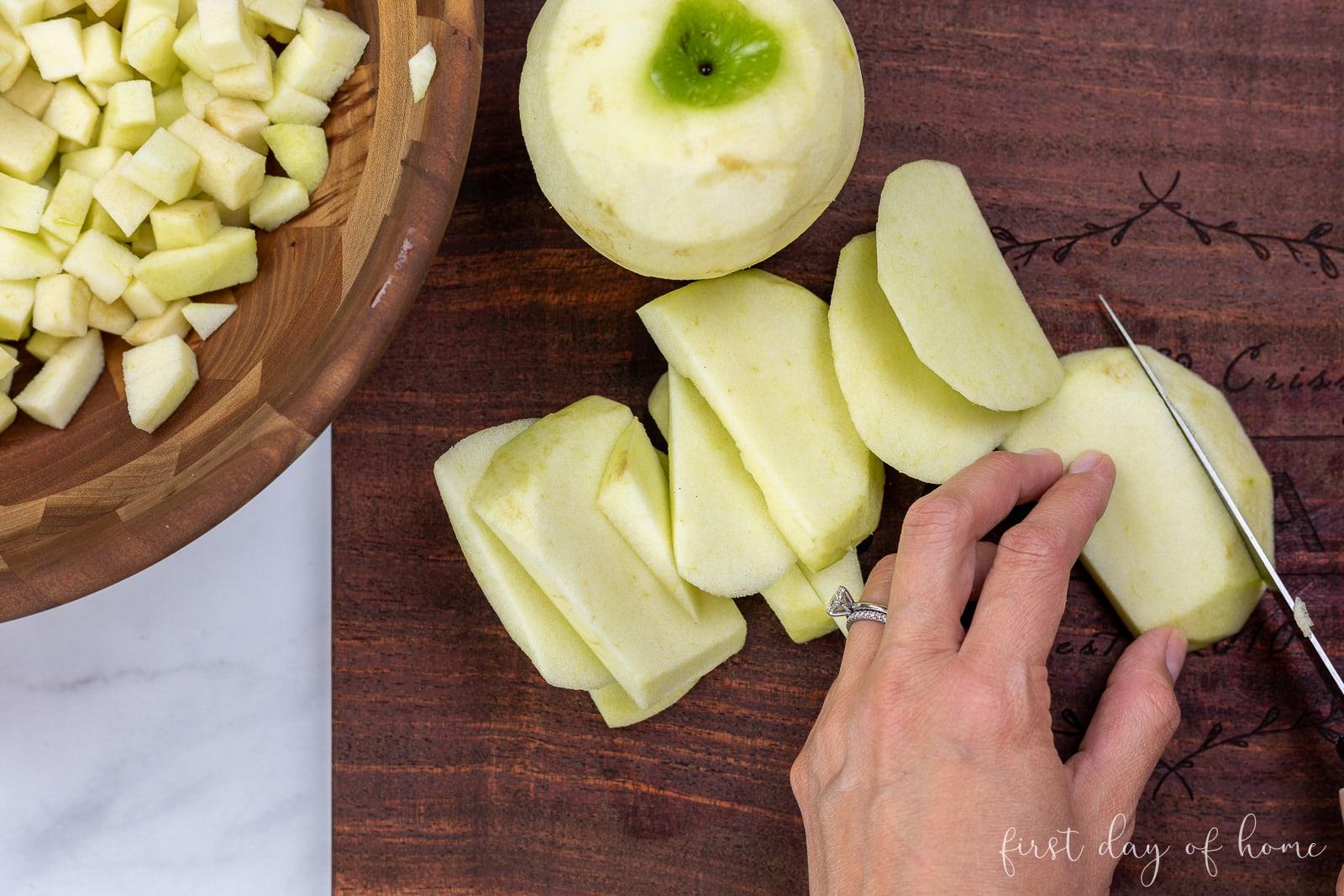 Slicing Granny Smith apples for apple empanada recipe