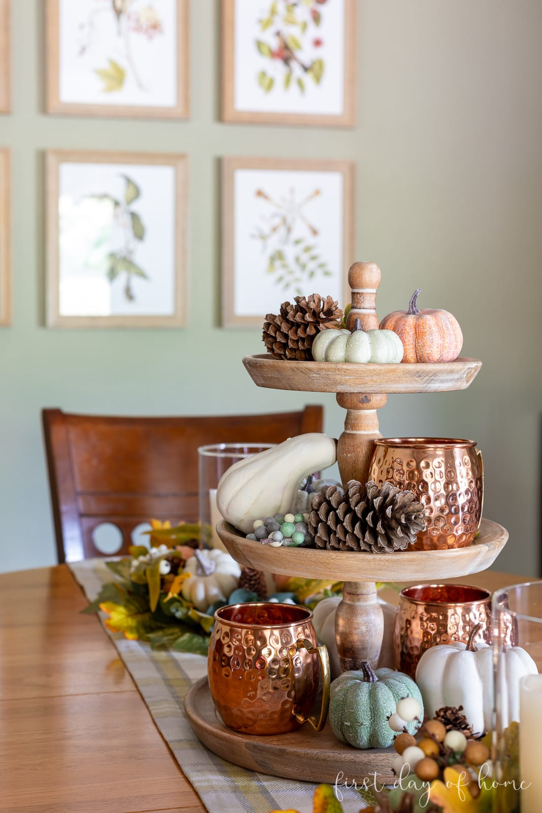 Fall breakfast room with tiered tray centerpiece and copper accents mixed with faux pumpkins