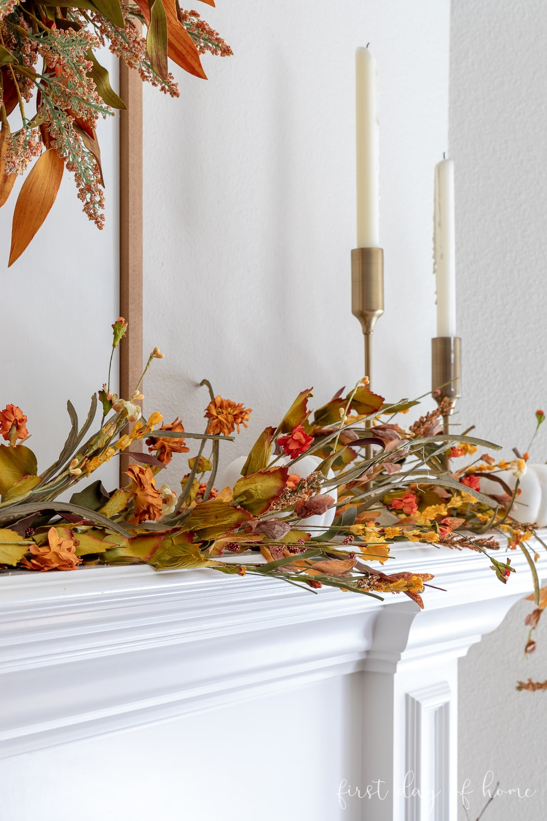 Fall fireplace garland with orange, yellow and green foliage