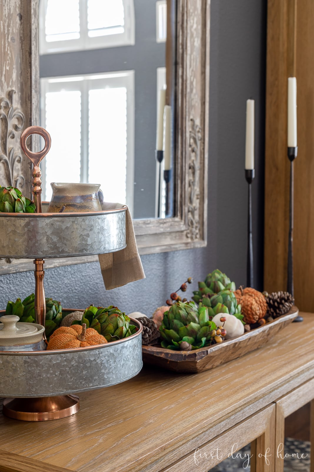 Sideboard styled with tiered galvanized metal tray, dough bowl filled with fall pumpkins and accents, and tall taper candleholders