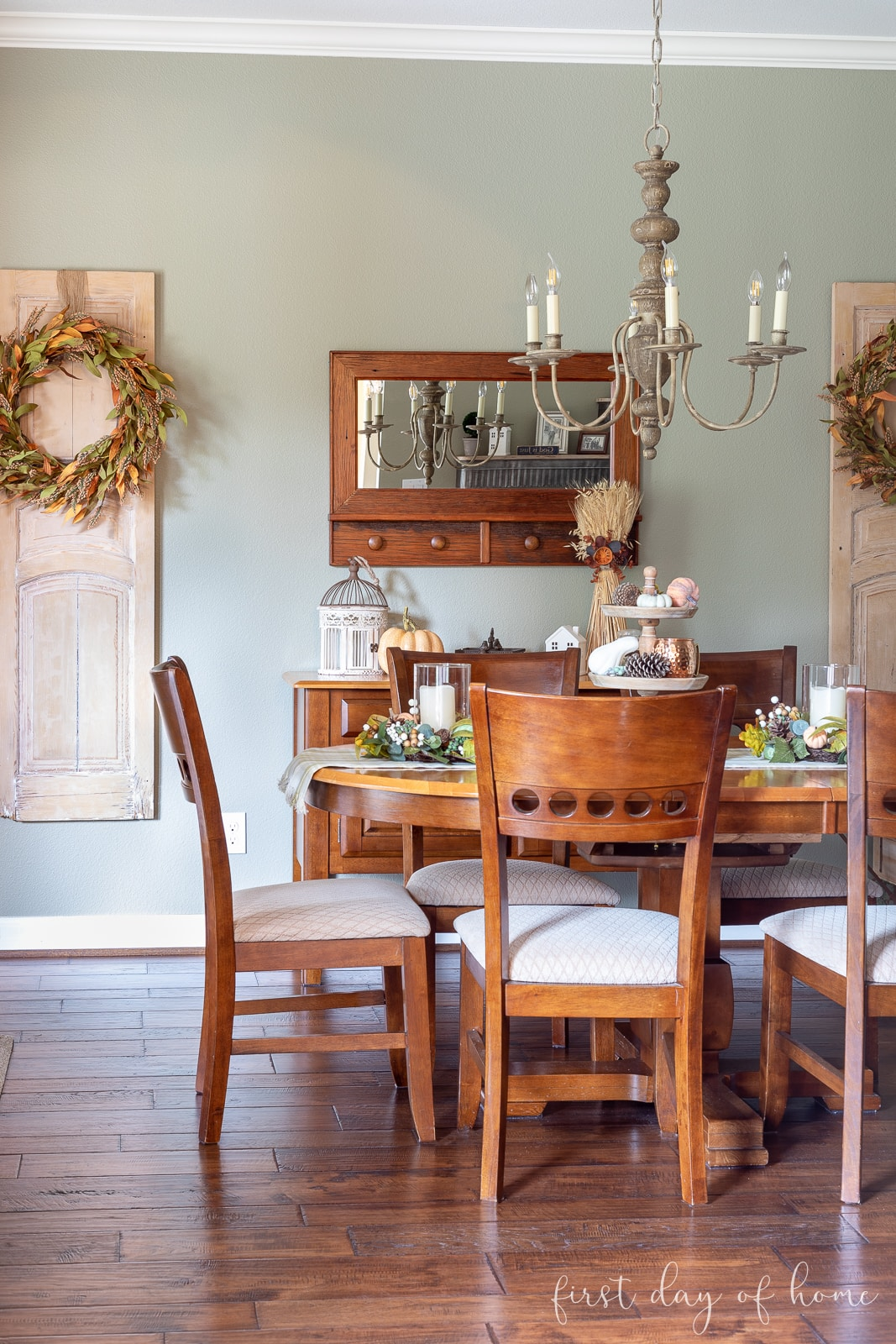 Fall breakfast room with farmhouse style decor including rustic door panels with fall wreaths