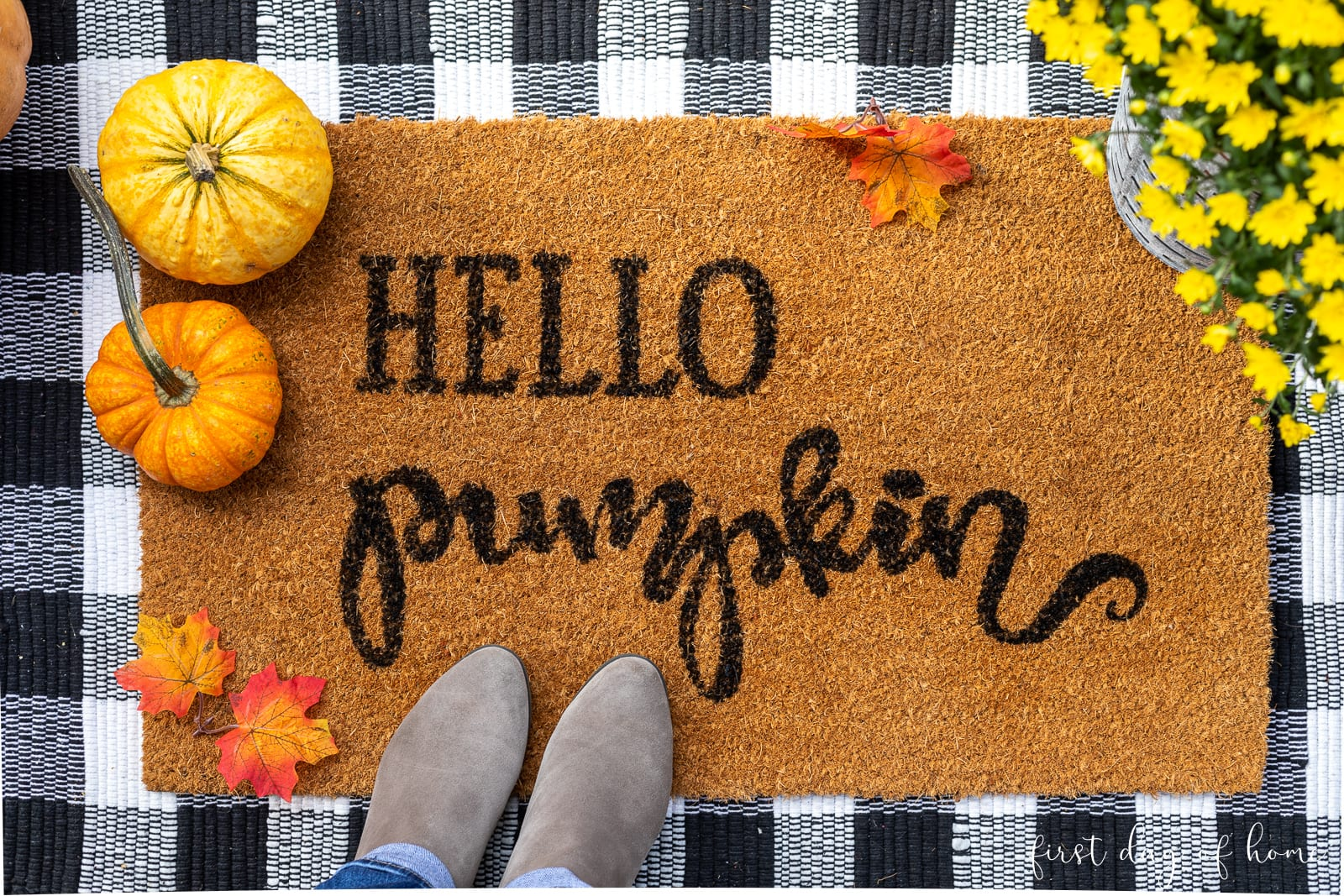 "DIY doormat made of coco fiber that reads ""Hello Pumpkin"" layered on top of buffalo plaid farmhouse rug with pumpkins"