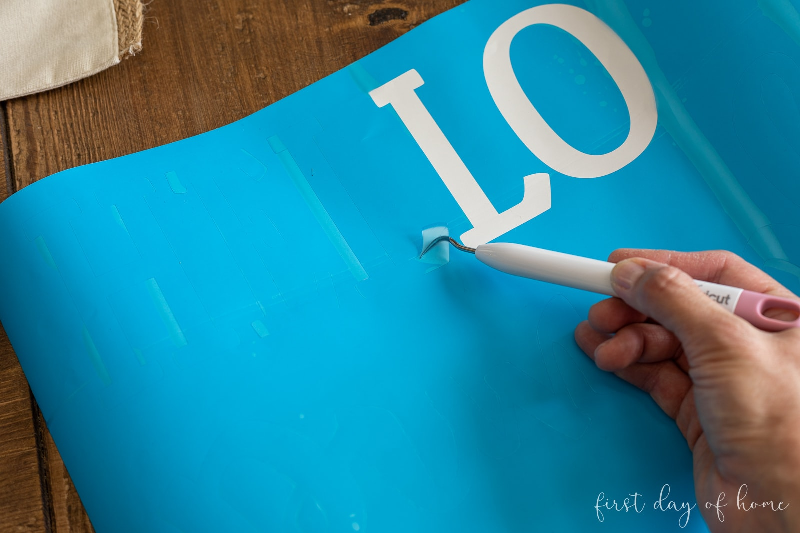 Weeding the letters from the stencil film
