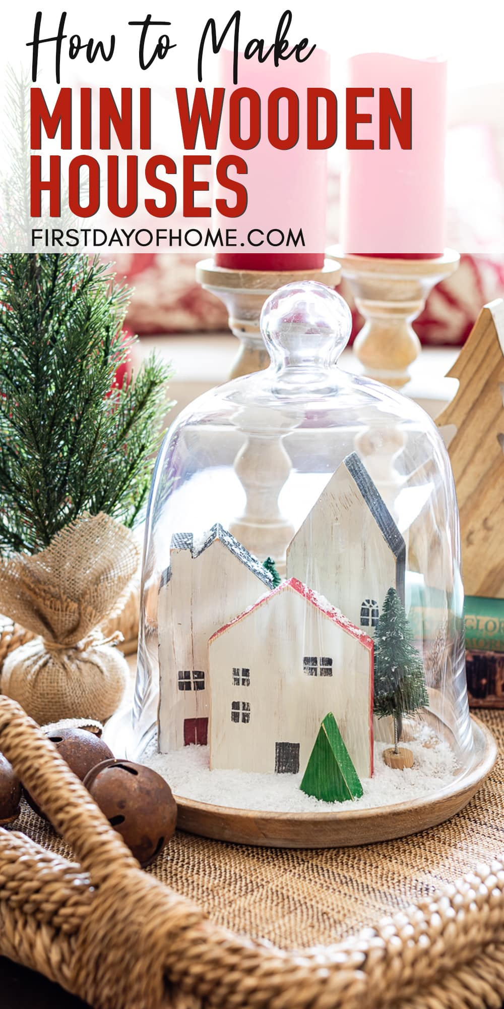 Mini wooden houses in Christmas cloche with fake snow and bottle brush trees