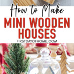 Mini wooden houses Christmas craft in a glass cloche dome on a coffee table