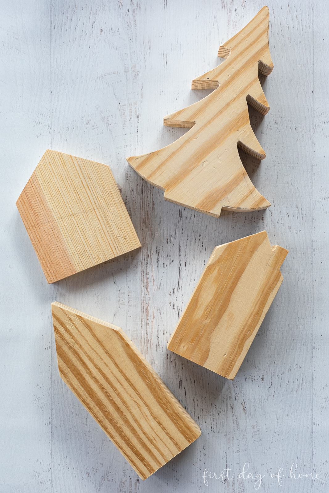 Unfinished wooden cutouts after sanding and before painting