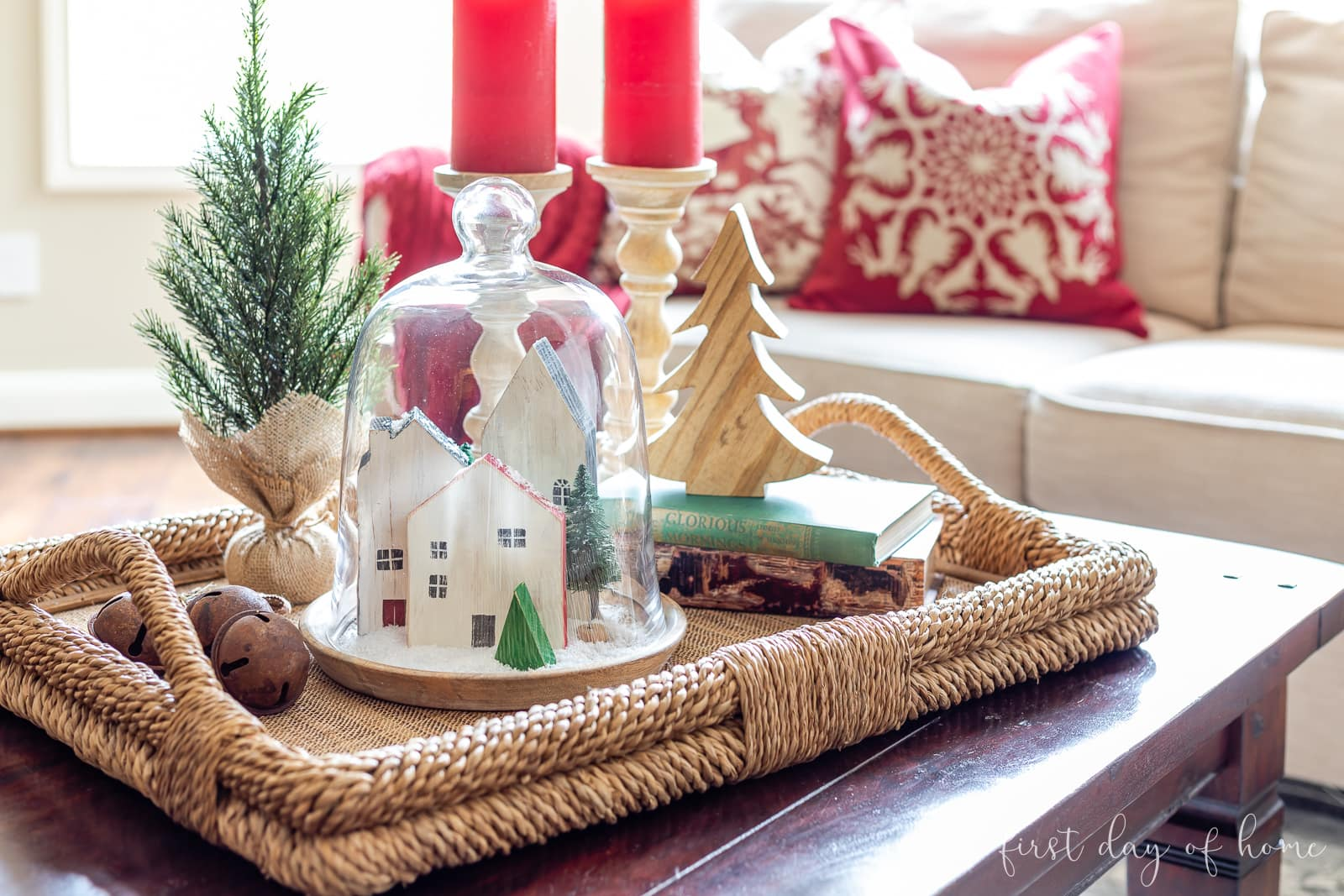 Christmas coffee table centerpiece with Christmas cloche containing mini houses made from wood