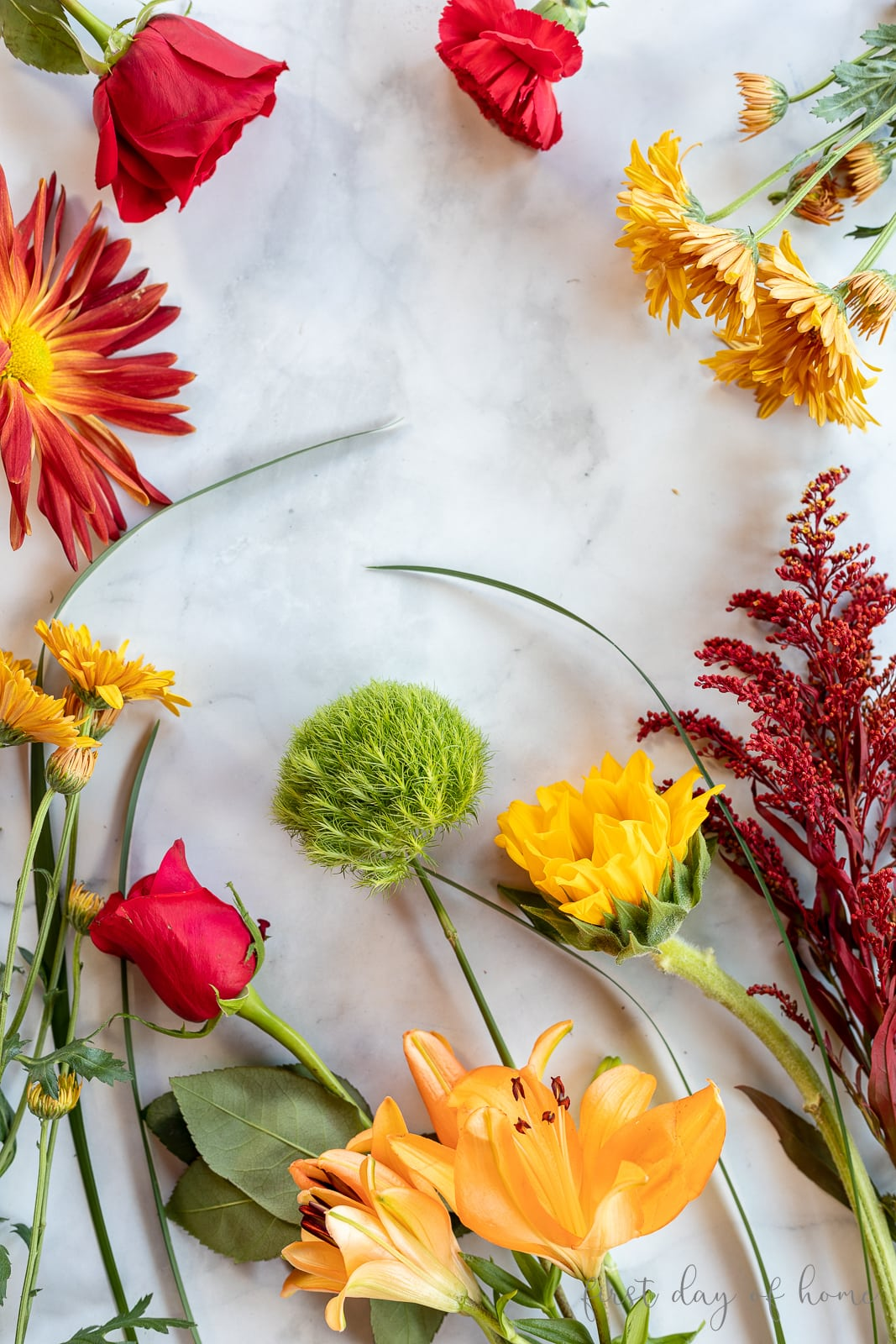 Fresh flowers from grocery store in yellow, red, orange and green