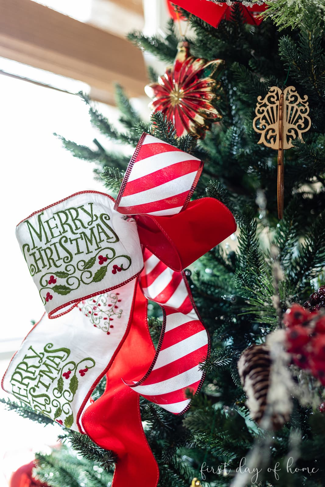 "Christmas tree ribbon with phrase ""Merry Christmas"" embroidered on it"