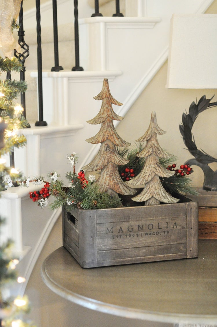 Christmas crate decor from Grace Home Interiors with wooden Christmas trees, faux greenery stems and berries