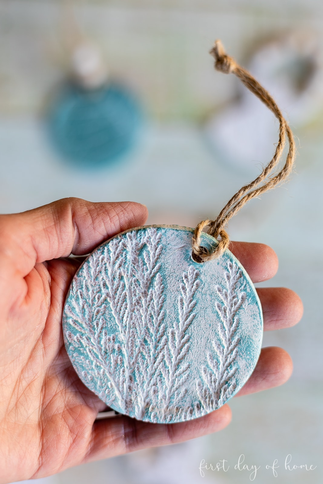 Painted clay ornament with imprint of cedar stem