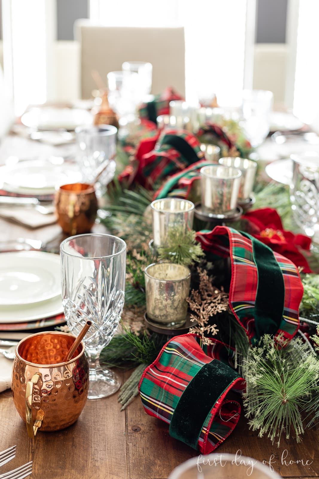 Christmas dining room table centerpiece with tartan plaid ribbon and green velvet ribbon