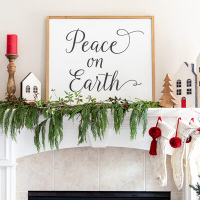 "DIY farmhouse sign that reads ""Peace on Earth"""