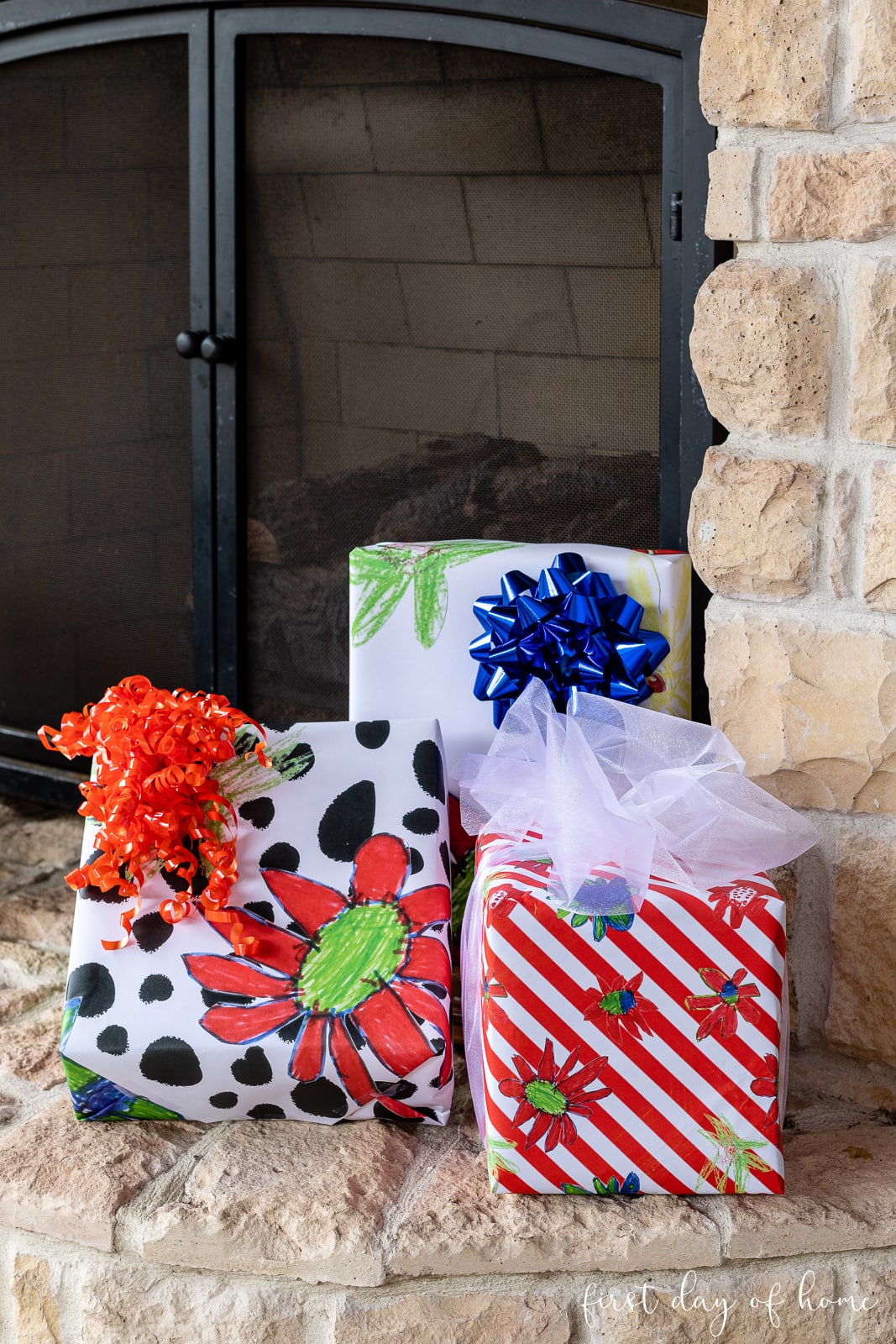 Trio of gifts wrapped in DIY wrapping paper in a red, white, green and black floral pattern