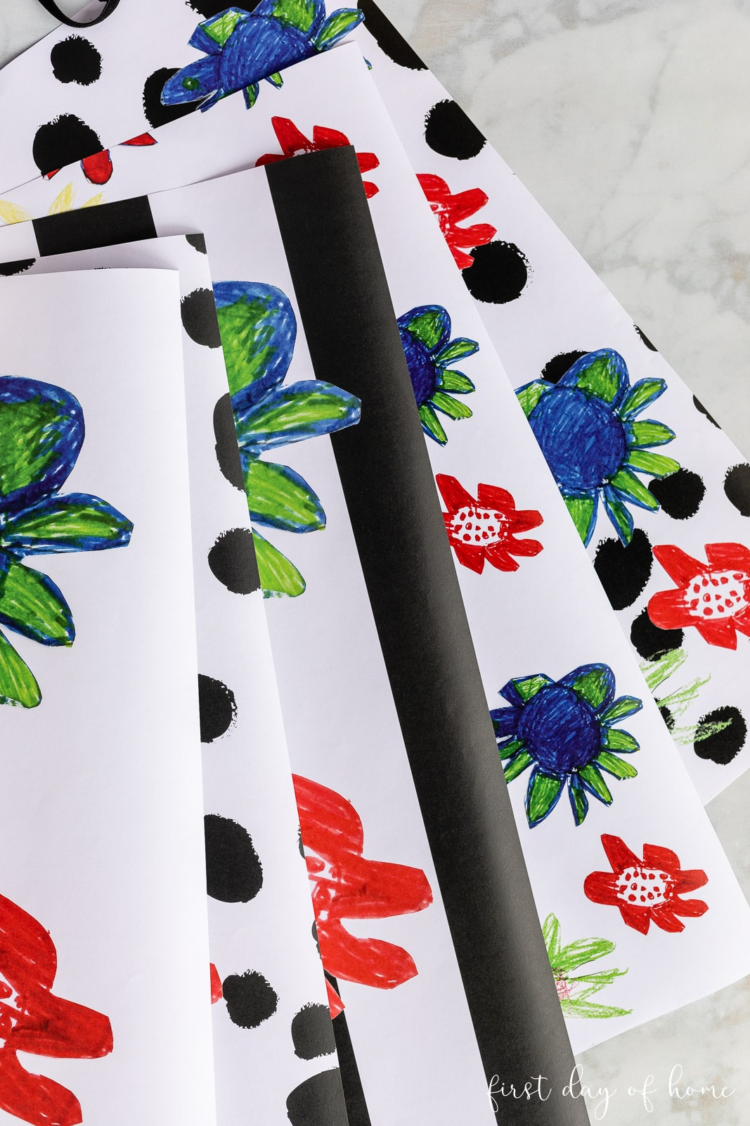 Sheets of customized DIY wrapping paper in black, white, red and green floral patterns