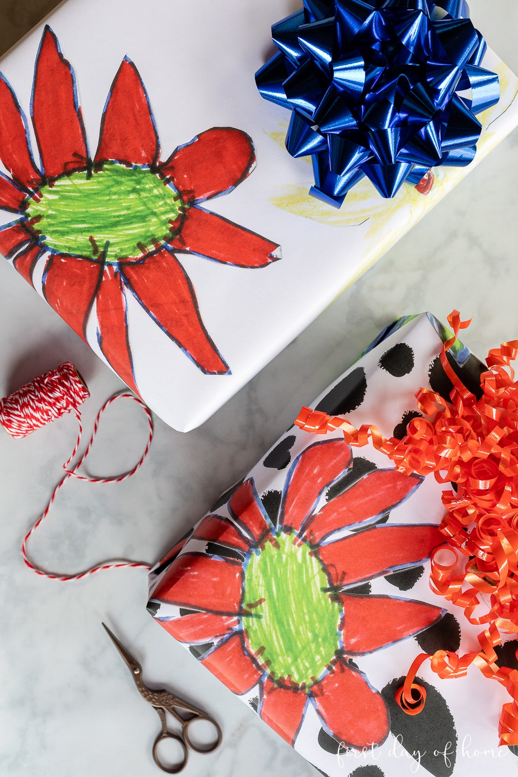 Presents wrapped in colorful wrapping paper with flower pattern made with art from kids