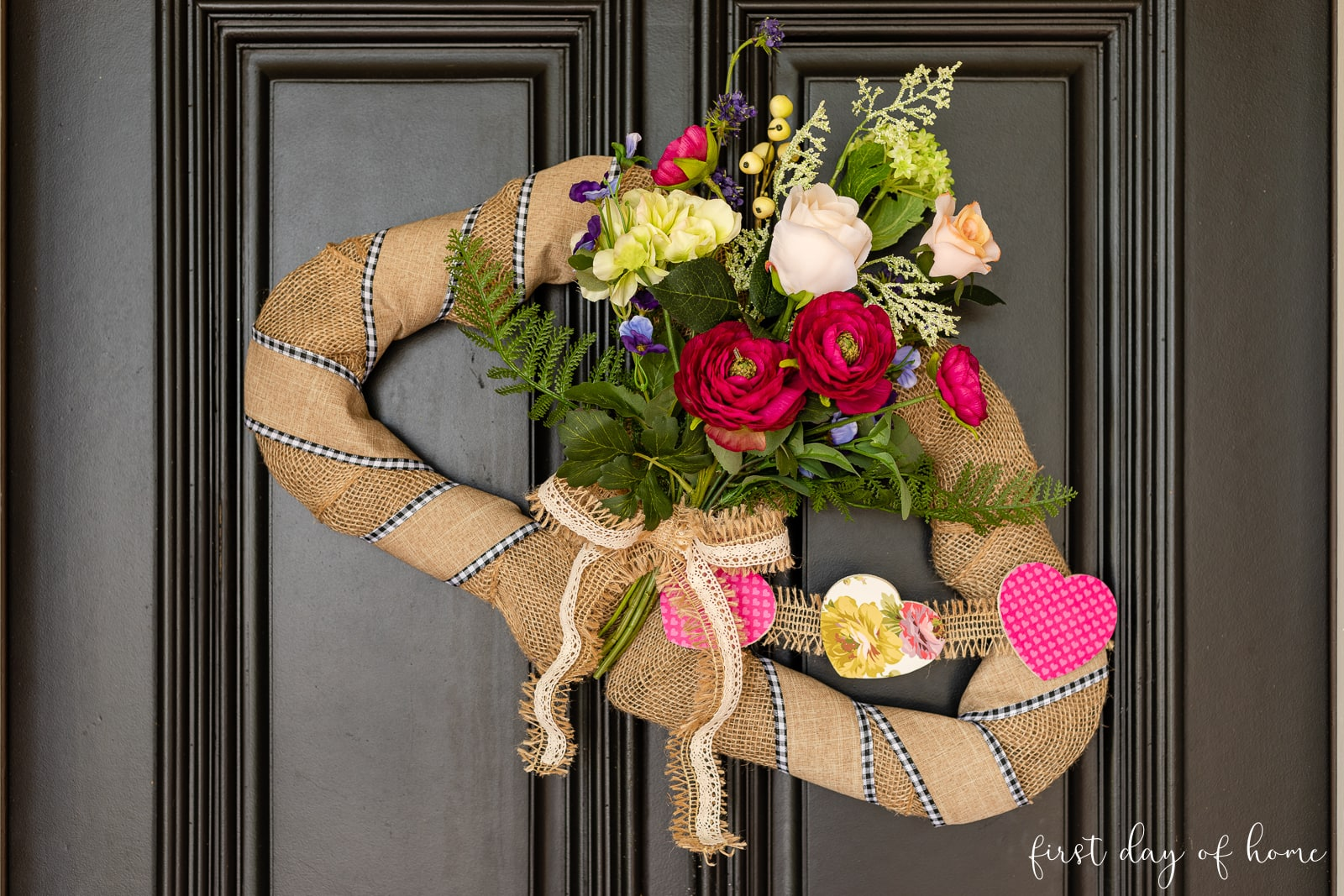 Double heart wreath for Valentine's Day with burlap ribbon, faux florals and wooden heart garland