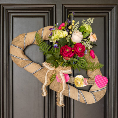 DIY Valentine Wreath with faux flowers and wooden heart banner