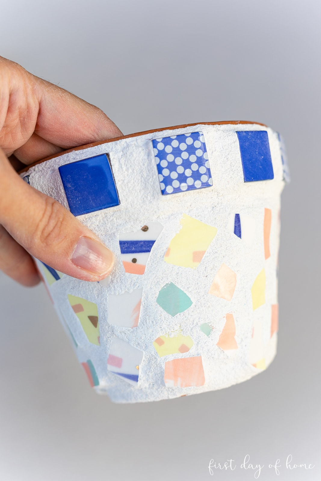 Mosaic flower pot after removing excess grout