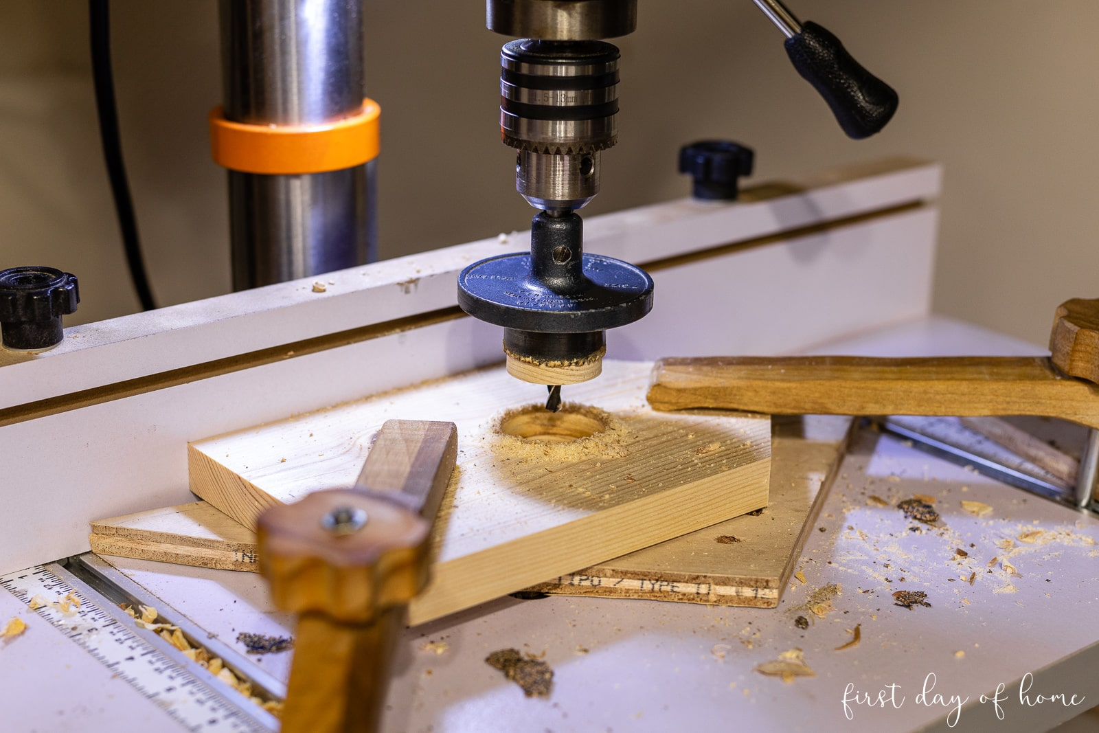 Using drill press to cut hole in birdhouse