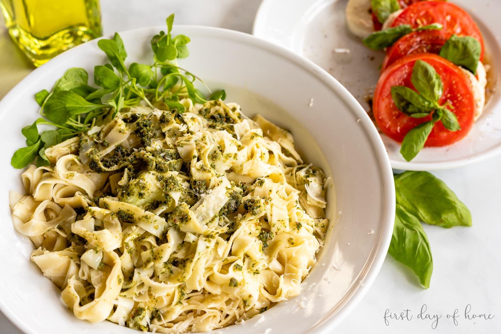 Homemade linguine pasta with scratch basil pesto sauce
