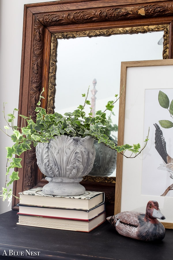 Faux concrete planter on stack of books sitting on dresser