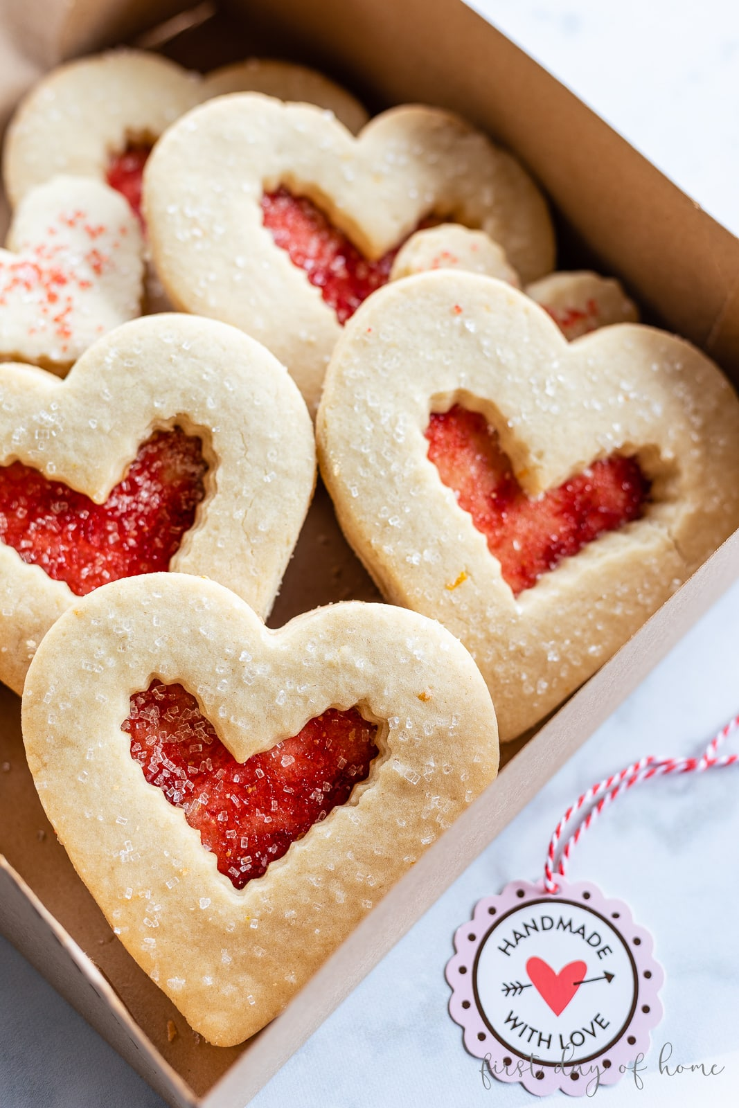 Heart shaped Valentine's Day sugar cookies with red jelly filling