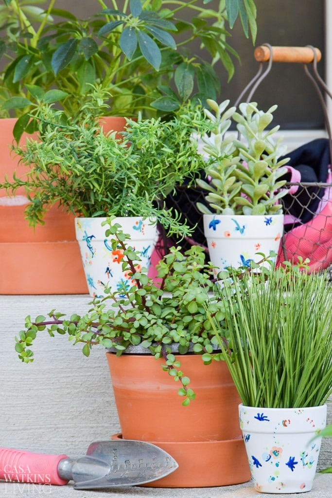 Anthropologie inspired painted pots with floral pattern sitting on patio steps