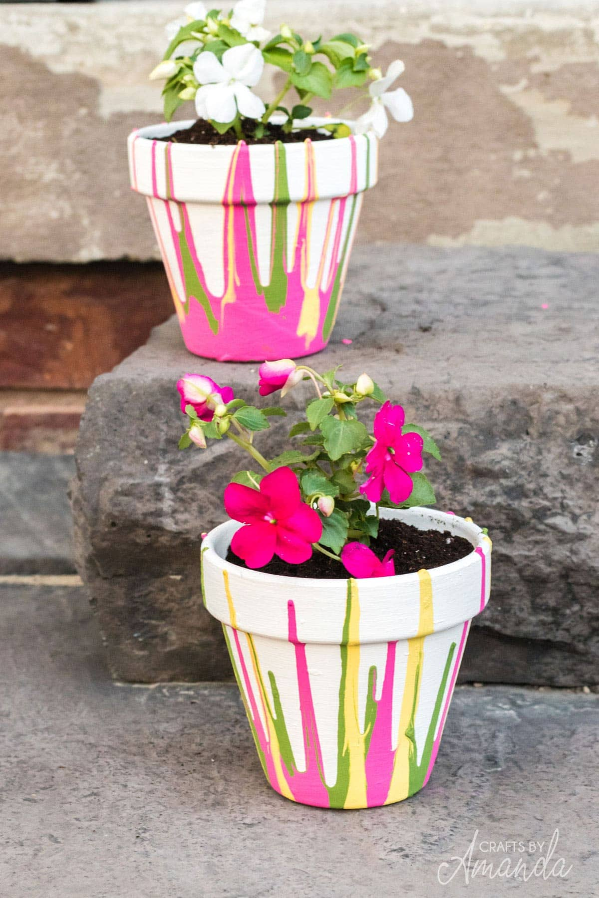 Drip painted clay pots with bright neon colors