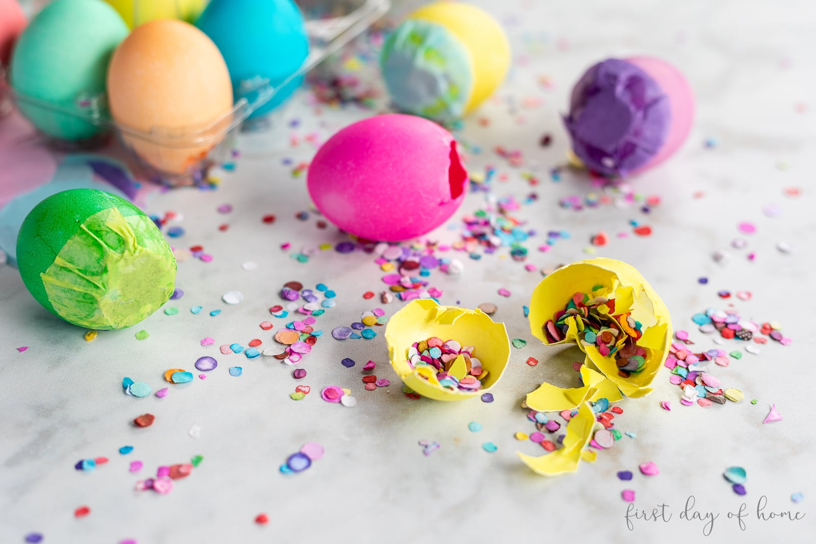 Confetti egg cracked open to reveal confetti inside with more eggs in background