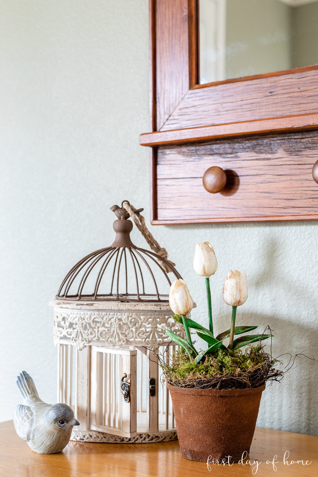 Spring decor with bird, cage and faux potted tulip