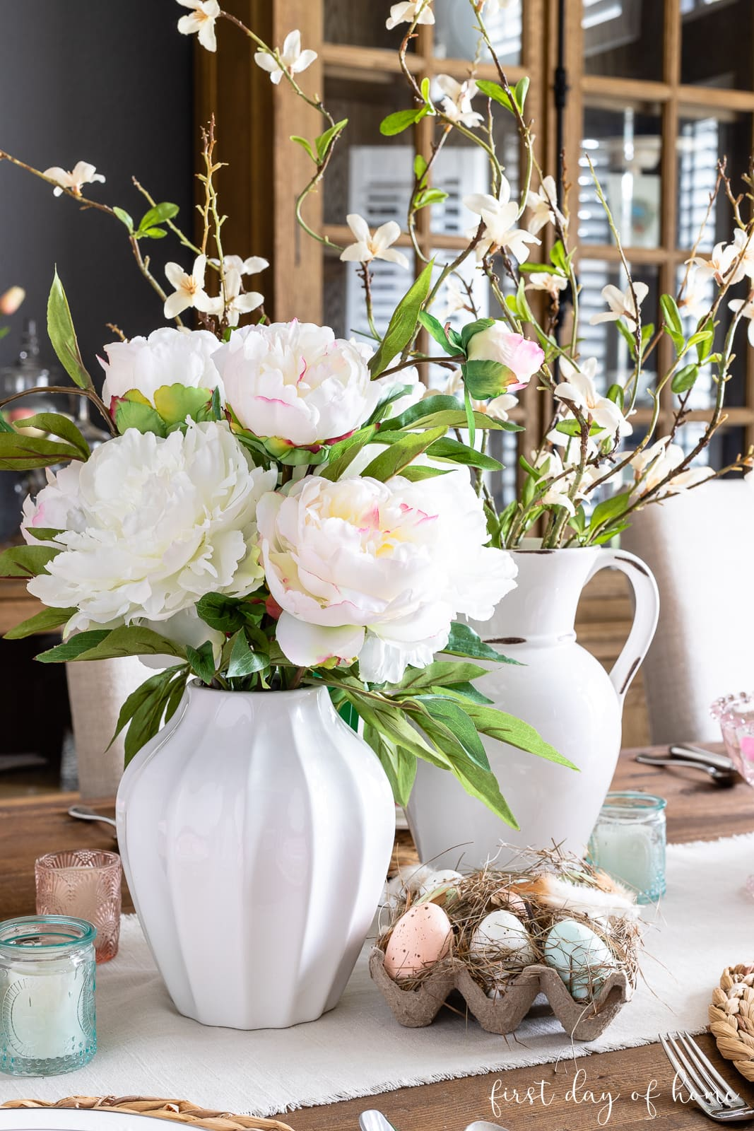 Spring floral centerpiece with faux peonies and egg crate with faux Easter eggs